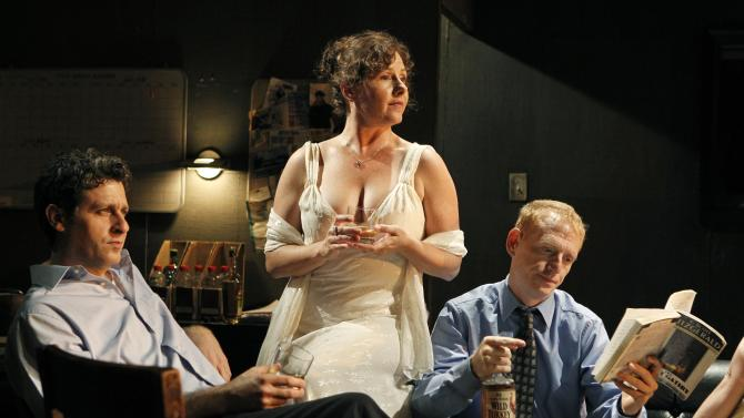 "In this theater publicity image released by The Public Theater, from left, Gary Wilmes, Laurena Allan and Scott Shepherd are shown in a scene from ""Gatz,"" at The Public Theater in New York. A marathon adaptation of 'The Great Gatsby' to return to The Public Theatre this spring. ""Gatz,"" directed by John Collins and featuring Scott Shepherd as the narrator, will begin previews on March 14 and run through May 6 for 28 performances. (AP Photo/The Public Theater, Joan Marcus)"