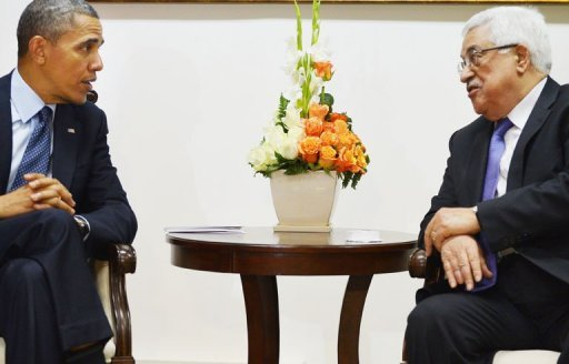 Barack Obama (left) and Mahmud Abbas meet in Ramallah today. The Palestinian president slammed violence against civilians, including Gaza rocket fire after two projectiles hit Israel as the US President visits