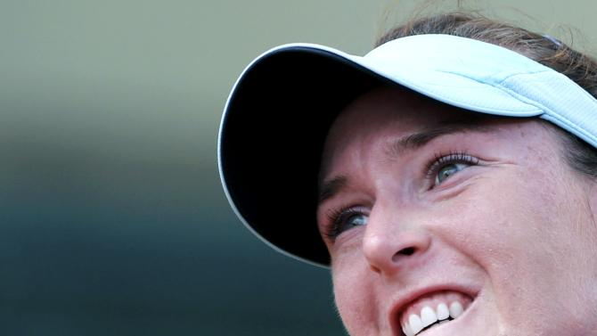 Madison Brengle of the U.S. reacts during the women's singles match against Samantha Stosur of Australia at the French Open tennis tournament at the Roland Garros stadium in Paris