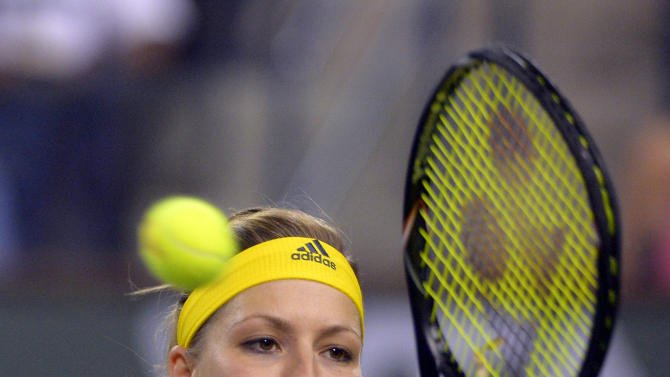 Maria Kirilenko, of Russia, returns a shot to Maria Sharapova, of Russia, during their semifinal match at the BNP Paribas Open tennis tournament, Friday, March 15, 2013, in Indian Wells, Calif. (AP Photo/Mark J. Terrill)