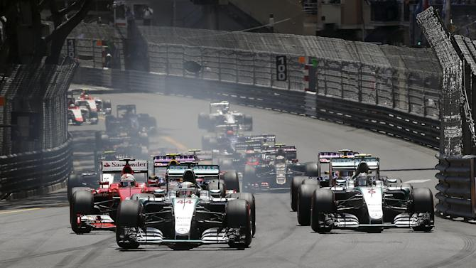 Mercedes Formula One driver Hamilton of Britain leads the group at the first curve of the first lap during the Monaco Grand Prix in Monaco
