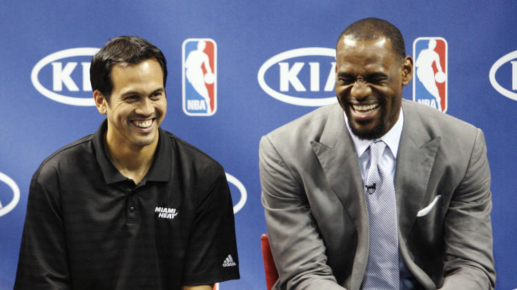 "Miami Heat head coach Erik Spoelstra, left, and LeBron James laugh during a ceremony to present James with the NBA MVP trophy, Saturday, May 12, 2012, in Miami. Calling the honor ""overwhelming"" but pointing to a ""bigger goal,"" James on Saturday became the eighth player in NBA history to win the MVP award three times. (AP Photo/Wilfredo Lee)"