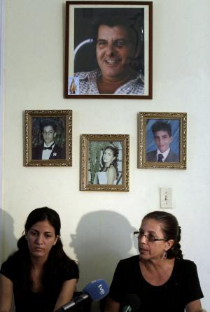 Ofelia Acevedo, right, widow of the late Cuban activist Oswaldo Paya and her daughter Rosa Maria Paya hold a news conference, in Havana, Cuba, Wednesday, Aug 1, 2012. Cuba has charged a Spanish citizen with the equivalent of vehicular manslaughter in the July 22 car accident that killed Acevedo's husband, a prominent dissident and another government opponent. (AP Photo/Franklin Reyes)