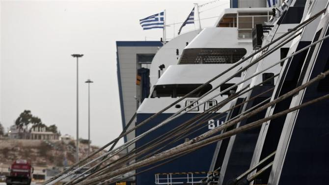 Ships are seen anchored during a 24-hour general labour strike at the port of Piraeus near Athens