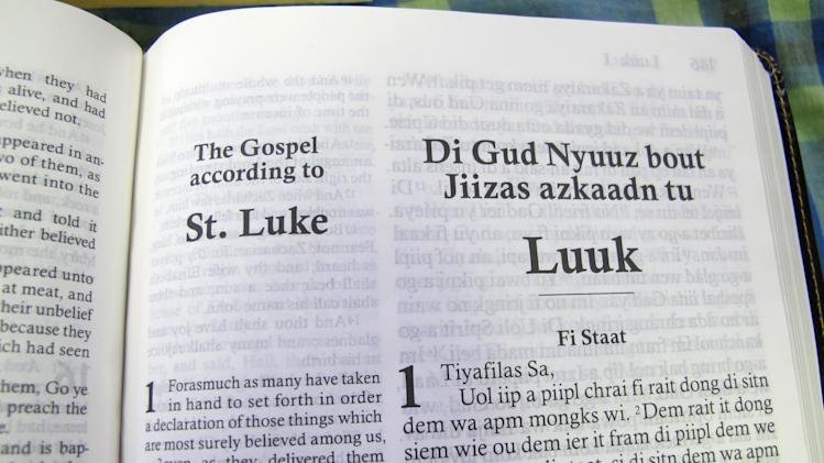 "In this Dec. 3, 2012 photo, the first page of the Gospel according to St. Luke, or the ""Di Gud Nyuuz bout Jiizas azkaadn tu Luuk,"" is shown at the office of the Bible Society of the West Indies in Kingston, Jamaica. After years of translation from the original Greek, the Bible Society is releasing in Jamaica print and audio CD versions of the first patois translation of the New Testament, or ""Di Jamiekan Nyuu Testiment."" For patois expert Hubert Devonish, a linguist who is coordinator of the Jamaican Language Unit at the University of the West Indies, the Bible translation is a big step toward getting the state to eventually embrace the creole language created by slaves. (AP Photo/David McFadden)"