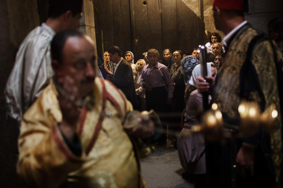 Syrian Orthodox worshippers celebrate a mass inside the Church of the Holy Sepulchre, traditionally believed to be the burial site of Jesus Christ, in Jerusalem's Old City, Saturday, April 7, 2012. (AP Photo/Bernat Armangue)
