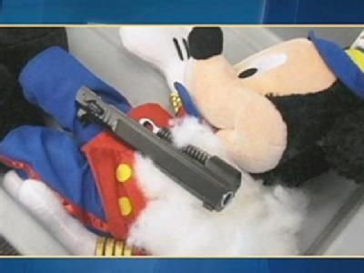Gun Parts Found In Stuffed Mickey Mouse At Airport