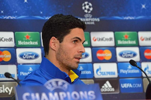 Arsenal's Mikel Arteta attends a press conference in Munich, southern Germany, Monday, March 10, 2014, ahead of their round of 16 second leg Champions League soccer match against FC Bayern on Tues