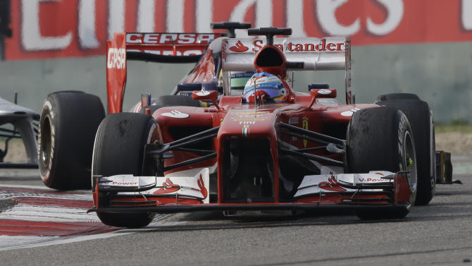 Ferrari driver Fernando Alonso of Spain steers his car during the Chinese Formula One Grand Prix in Shanghai, China, Sunday, April 14, 2013. (AP Photo/Mark Baker)