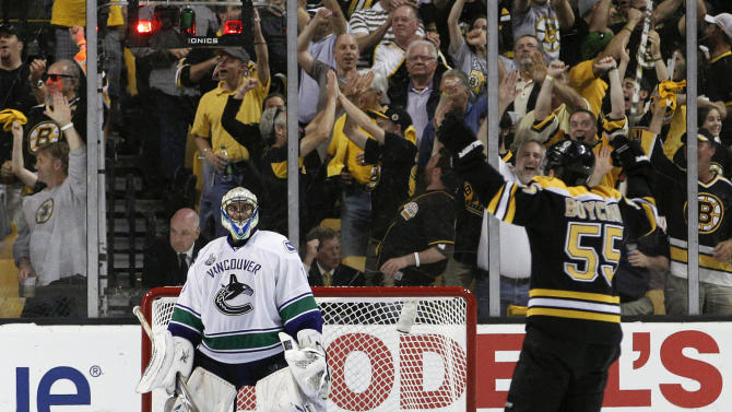 Vancouver Canucks goalie Roberto Luongo (1) reacts as Boston Bruins defenseman Johnny Boychuk (55) skates to celebrate with teammates after a goal by Boston Bruins center Rich Peverley (49) in the third period during Game 4 of the NHL hockey Stanley Cup finals, Wednesday, June 8, 2011, in Boston. (AP Photo/Elise Amendola)