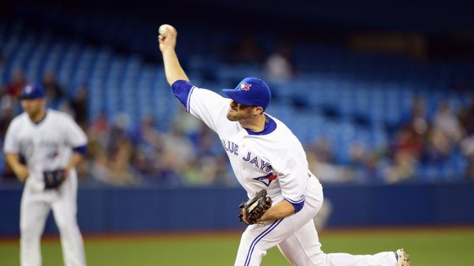 Toronto Blue Jays relief pitcher Bo Schultz works against the Boston Red Sox during seventh inning American League baseball action in Toronto on Tuesday, June 30, 2015.  (Frank Gunn/The Canadian Press via AP) MANDATORY CREDIT