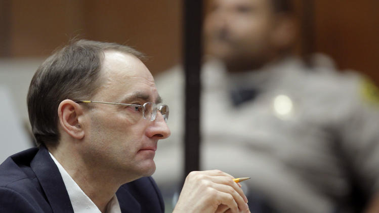 Christian Karl Gerhartsreiter, listens during opening statements in his trial, in Los Angeles Criminal Court on Monday, March 18, 2013. A prosecutor told jurors Monday he will prove a cold-case murder allegation against the German immigrant who spent years moving through U.S. society under a series of aliases, most notoriously posing as a member of the fabled Rockefeller family. He has pleaded not guilty to the killing of John Sohus, 27, who disappeared with his wife, Linda, in 1985 while Gerhartsreiter, using an alias was a guest cottage tenant at the home of Sohus' mother, where the couple lived. (AP Photo/Nick Ut )