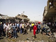 Iraqi rescue and security personnel inspect the damage following a truck bomb in a crowded market in Diwaniya. A truck bomb blamed on Al-Qaeda killed 26 people at a crowded market in central Iraq on Tuesday while attacks elsewhere claimed 12 lives, the latest victims of a spike in nationwide unrest