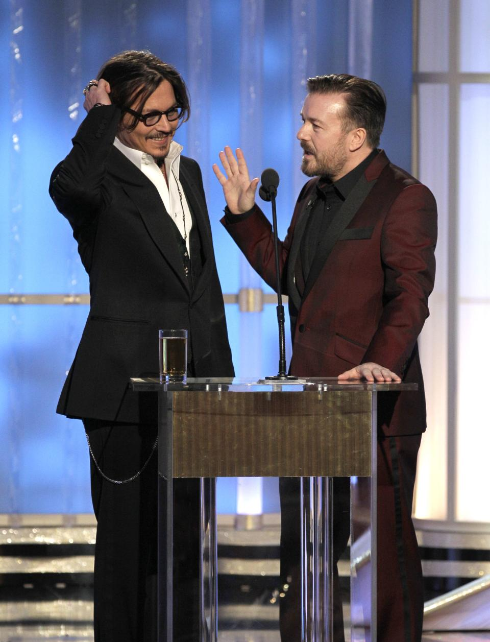 In this image released by NBC, presenter Johnny Depp, left, and host Ricky Gervais are shown during the 69th Annual Golden Globe Awards on Sunday, Jan. 15, 2012 in Los Angeles. (AP Photo/NBC, Paul Drinkwater)
