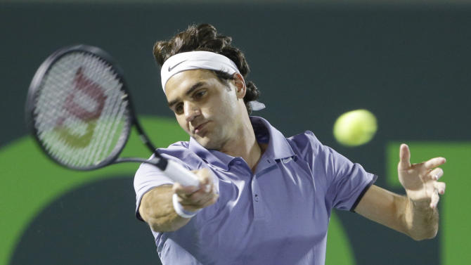 Roger Federer of Switzerland, returns a shot from Kei Nishikori of Japan, at the Sony Open Tennis tournament, Wednesday, March 26, 2014 in Key Biscayne, Fla. (AP Photo/Wilfredo Lee)