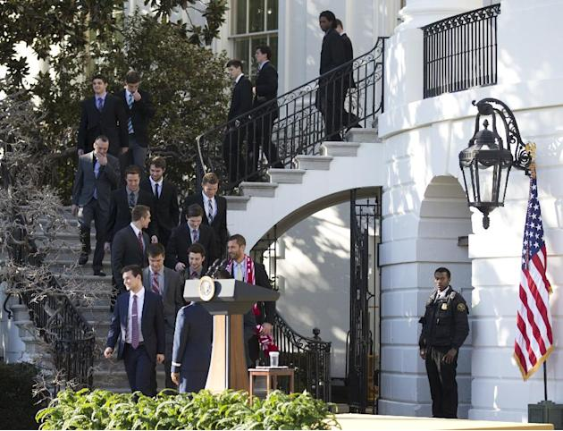 Members of the Indiana University men's soccer walk down the steps of the White House in Washington, Monday, March 10, 2014, as they join a gathering on the South Lawn where President Barack Obama hon