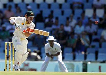 Australia's David Warner plays a shot during the first day of their cricket test match against South Africa in Centurion February 12, 2014. REUTERS/Siphiwe Sibeko