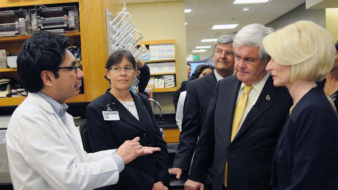 Republican presidential candidate Newt Gingrich and wife Callista talk with Richard D. Lopez, M.D., Assistant Dean for Research, Pam Bounelis and Ed Partridge, M.D., director of UAB Comprehensive Cancer Center, and as they visit the Comprehensive Cancer Center at UAB Wednesday. March 7, 2012 in Birmingham, Ala. (AP Photo/The Birmingham News, Hal Yeager) MAGS OUT