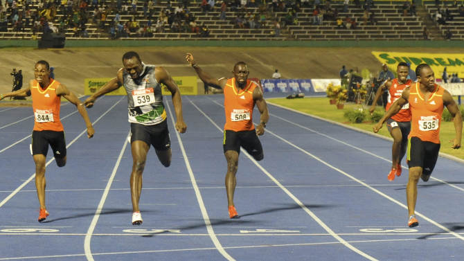 Sprinter Yohan Blake, far right, crosses the finish line ahead of world-record holder Usain Bolt, second from left, Nickel Ashmeade, center, Warren Weir, left, and Jason Young to win the 200m final at Jamaica's Olympic trials in Kingston, Jamaica, Sunday, July 1, 2012. Blake edged Bolt by 0.03 finishing in 19.80 seconds. (AP Photo/Collin Reid)