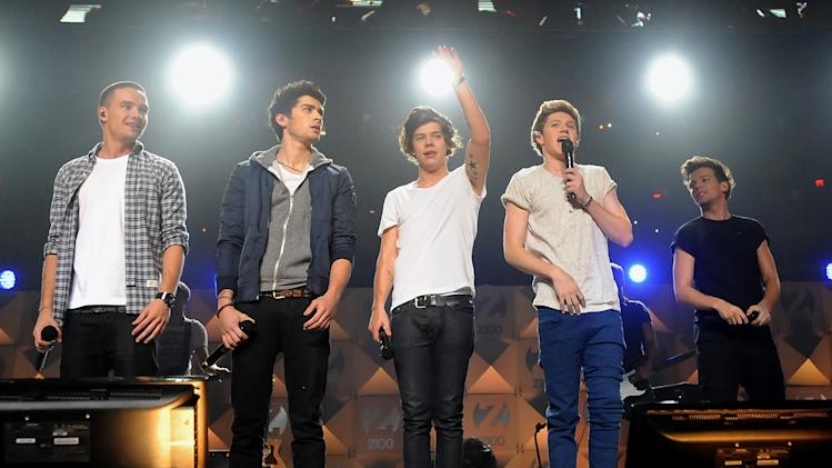 FILE - In this Dec. 7, 2012 file photo, members of One Direction, from left, Liam Payne, Zayn Malik, Harry Styles, Niall Horan, and Louis Tomlinson perform at Z100's Jingle Ball 2012  in New York. The band has announced plans for an ambitious world tour in 2014. Plans call for the youthful chart-toppers to play major stadiums in Latin America, Britain and Ireland during the first leg of the mega-tour that begins next April. (Photo by Evan Agostini/Invision/AP, file)