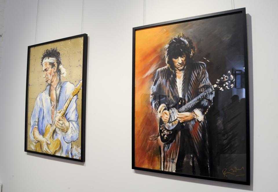 "Rolling Stones guitarist Ronnie Wood's art work is on display during a news conference to unveil his new art exhibition ""Faces, Time and Places"" on Monday, April 9, 2012 in New York. (AP Photo/Evan Agostini)"