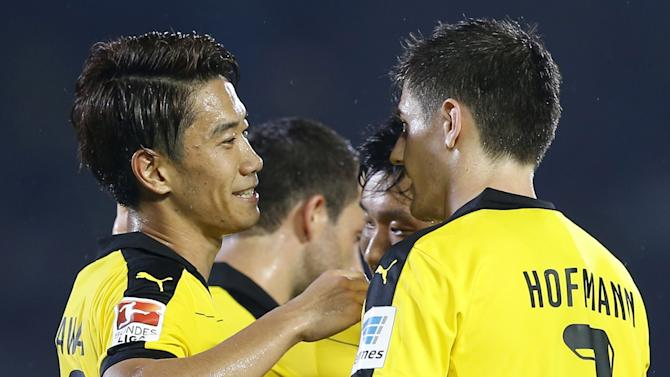 Borussia Dortmund's Kagawa is congratulated by Hofmann and his teammates after scoring during their friendly match against Kawasaki Frontale as part of Borussia Dortmund's Asia Tour in Kawasaki