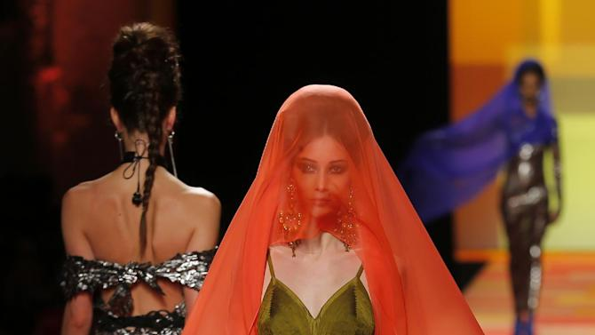 A model wears a creation for French fashion fashion designer Jean-Paul Gaultier's Spring-Summer 2013 Haute Couture fashion collection, presented in Paris, Wednesday, Jan.23, 2013. (AP Photo/Jacques Brinon)