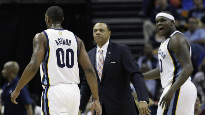 Memphis Grizzlies' Lionel Hollins watches as Memphis Grizzlies' Darrell Arthur (00) and Zach Randolph return to the bench during the first half of Game 3 in a first-round NBA basketball playoff series in Memphis, Tenn., Thursday, April 25, 2013. The Grizzlies defeated the Clippers 94-82. (AP Photo/Danny Johnston)
