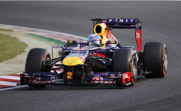 Red Bull Formula One driver Vettel of Germany drives during the qualifying session of the Japanese F1 Grand Prix at the Suzuka circuit