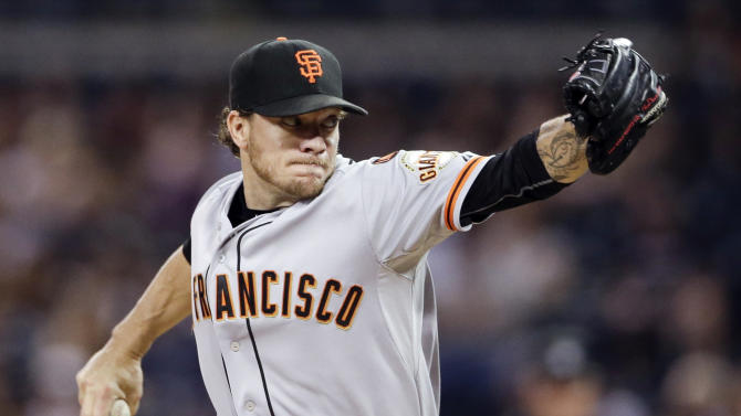 FILE - In this Sept. 23, 2015, file photo, San Francisco Giants starting pitcher Jake Peavy works against a San Diego Padres batter during the first inning of a baseball game in San Diego. California lawmakers have taken the first step toward banning smokeless tobacco in state ballparks. (AP Photo/Gregory Bull, File)