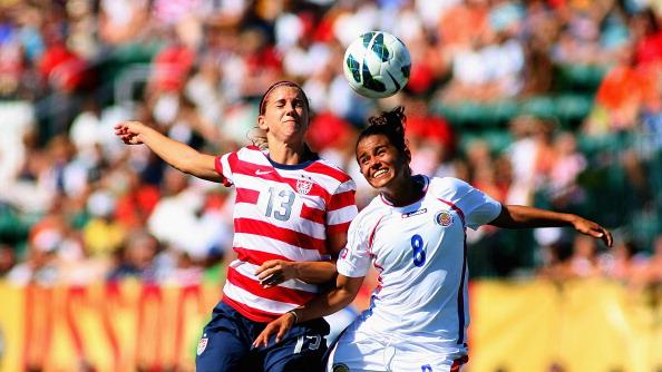 Alex Morgan #13 of the United States Womens National Team attacks against Daniela Cruz #8 of Costa Rica during their friendly match at Sahlen's Stadium on September 1, 2012 in Rochester, New York. The US won 8-0. (Photo by Rick Stewart/Getty Images)