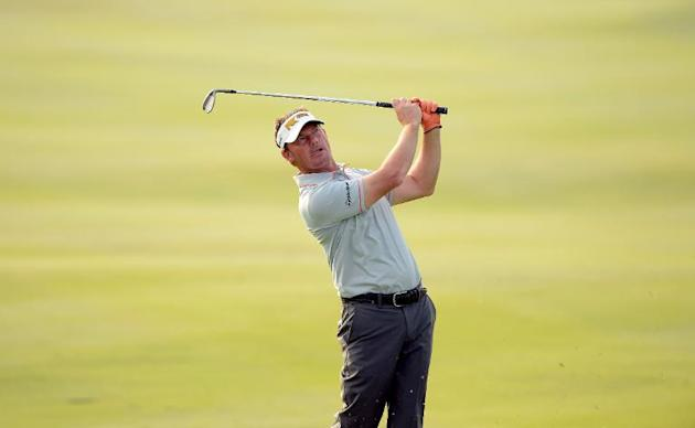 This handout photo taken and released by the Asian Tour on December 12, 2013 shows Alex Cejka of Germany taking part in the first day of the Thai Golf Championship at the Amata Spring Country Club in