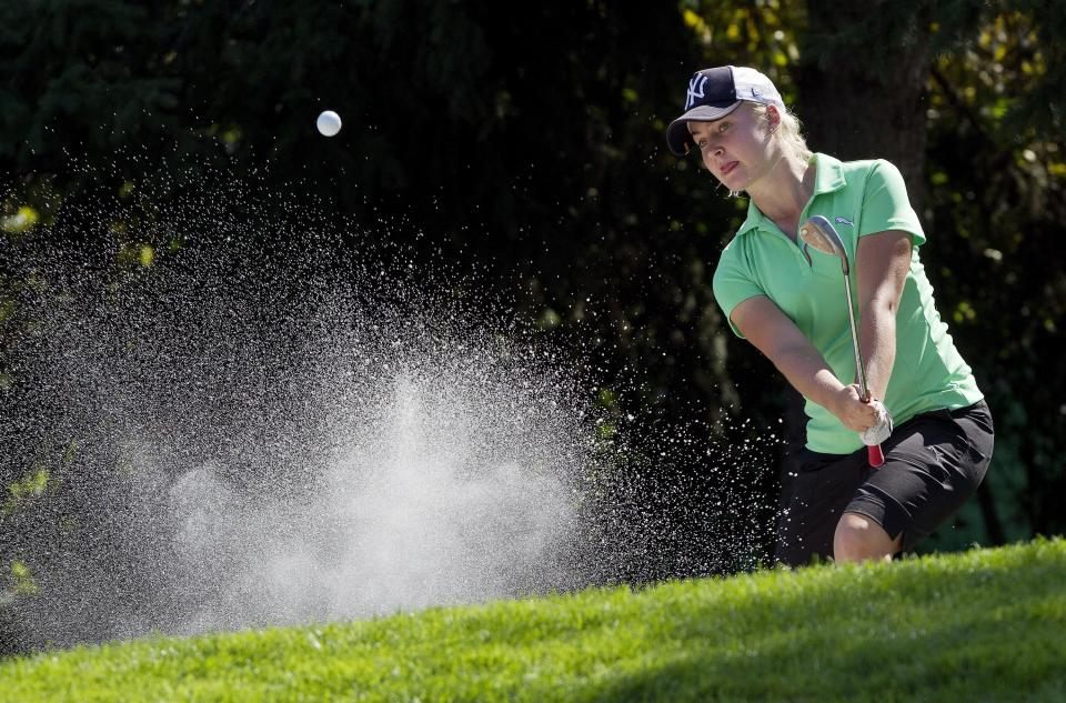 Charley Hull, of England, hits out of a bunker on the 14th hole during the third round of the Canadian Women's Open golf tournament in Edmonton, Alberta, Saturday, Aug. 24, 2013. (AP Photo/The Canadian Press, Jason Franson)