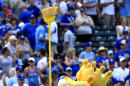 Kansas City Royals mascot Sluggerrr waves a broom following a baseball game against the Chicago White Sox at Kauffman Stadium in Kansas City, Mo., Sunday, May 29, 2016. The Royals defeated the White Sox 5-4. The Royals swept the series with the White Sox. (AP Photo/Orlin Wagner)