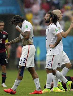 United States' Jermaine Jones (13), Kyle Beckerman (15) and Michael Bradley, far right, walk over the pitch during the group G World Cup soccer match ...