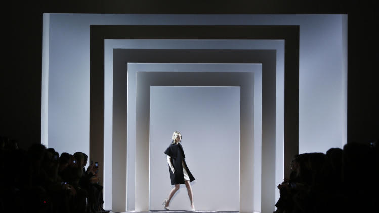 Fashion from the Fall 2013 Vera Wang collection is modeled on Tuesday, Feb. 12, 2013 in New York.  (AP Photo/Bebeto Matthews)
