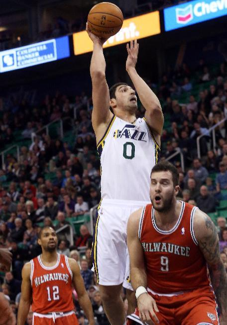 Utah Jazz's Enes Kanter (0) takes a shot over Milwaukee Bucks' Miroslav Raduljica (9) during the second half of an NBA basketball game Thursday, Jan. 2, 2014, in Salt Lake City. The Jazz won 9