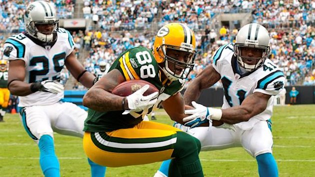 Green Bay Packers tight end Jermichael Finley (88) catches a pass in the endzone against Carolina Panthers cornerback Captain Munnerlyn (41) during their NFL football game in Charlotte