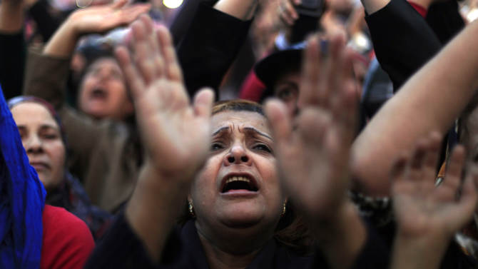 Egyptian protesters chant slogans at rally in Tahrir Square in Cairo, Egypt, Tuesday, Nov. 27, 2012. Egyptians flocked to Cairo's central Tahrir square on Tuesday for a protest against Egypt's president in a significant test of whether the opposition can rally the street behind it in a confrontation aimed at forcing the Islamist leader to rescind decrees that granted him near absolute powers. (AP Photo/ Khalil Hamra)