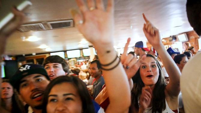 USA fans react while watching the Women's World Cup final soccer match against Japan at the Underground Pub and Grill in Hermosa Beach, California