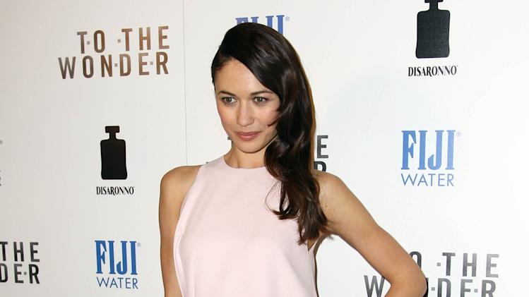 "Actress Olga Kurylenko arrives at the premiere of ""To The Wonder"" hosted by FIJI Water on Tuesday, April 9, 2013 in Los Angeles. (Photo by Matt Sayles/Invision for Fiji Water/AP Images)"