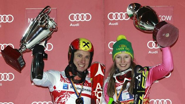 Winners Lena Duerr (R) of Germany and Marcel Hirscher of Austria pose with their trophies on the podium after the FIS Ski World Cup City Event in Moscow, January 29, 2013 (Reuters)