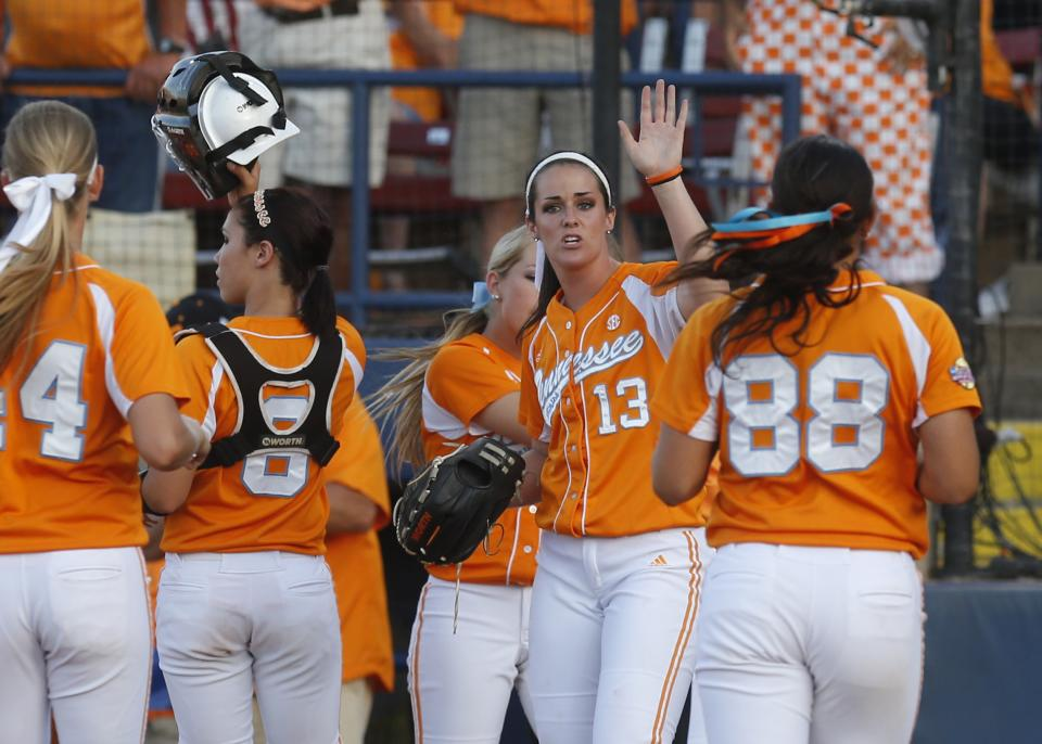 Tennessee pitcher Ellen Renfroe (13) gets high fives from her teammates following the third inning of the first game of the best of three Women's College World Series NCAA softball championship series against Oklahoma in Oklahoma City, Monday, June 3, 2013. (AP Photo/Sue Ogrocki)