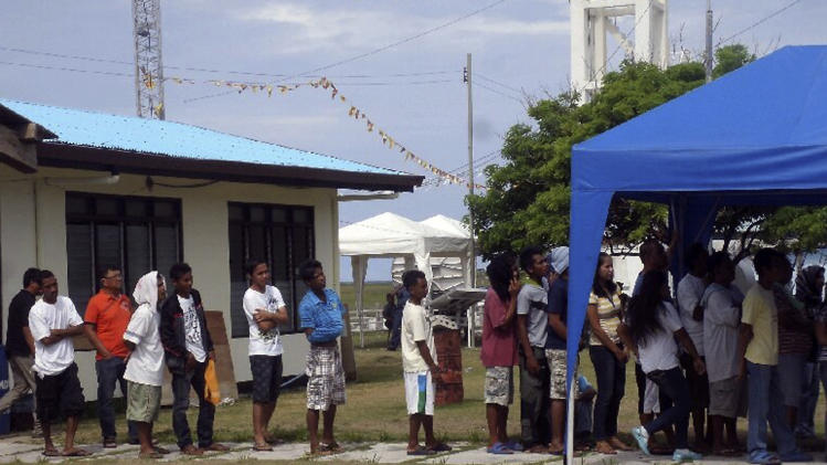 Filipinos living on the Philippine-claimed Pag-asa island at the disputed Spratlys Group of islands in the South China Sea, queue to vote in the country's mid-term elections Monday, May 13, 2013 in Western Philippines in this photo released by the Armed Forces of the Philippines Western Command (WESCOM) Public Affairs Office. More than 50 million Filipinos are expected to troop to polling centers to elect senators, congressmen and down to municipal mayors for the country's midterm elections. A total 228 voters are registered on Pag-asa island. (AP Photo/WESCOM PAO)  EDITORIAL USE ONLY  NO SALES