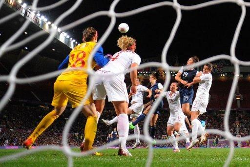 United States forward Alex Morgan (4th R) heads the winning goal