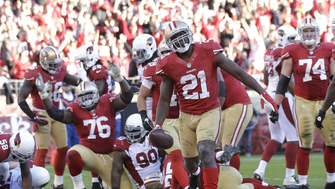 San Francisco 49ers running back Frank Gore (21) celebrates after scoring on a 2-yard touchdown run against the Arizona Cardinals during the fourth quarter of an NFL football game in San Francisco, Sunday, Dec. 30, 2012. (AP Photo/Marcio Jose Sanchez)