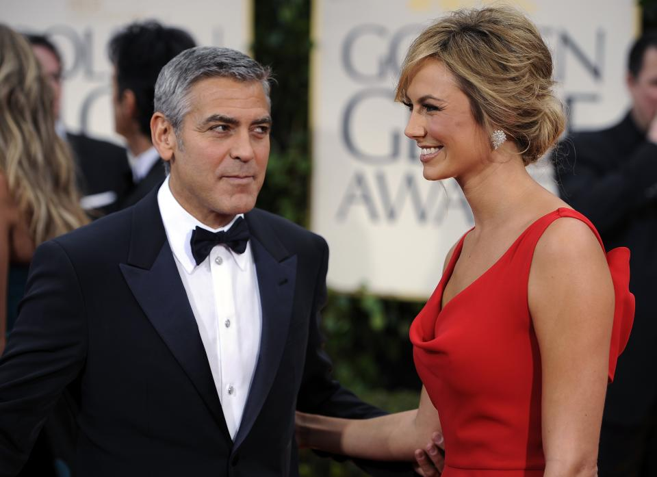 George Clooney and Stacy Keibler arrive at the 69th Annual Golden Globe Awards Sunday, Jan. 15, 2012, in Los Angeles. (AP Photo/Chris Pizzello)