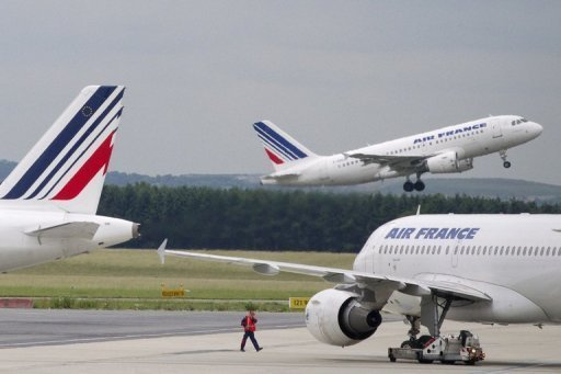 <p>Air France planes at Roissy-Charles de Gaulle airport in Roissy-en-France, outside Paris, on June 1. French airline Air France said Thursday it is to cut over 5,000 jobs or around 10 percent of its workforce in voluntary departures by 2014.</p>