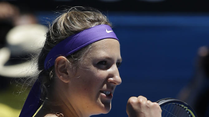 Victoria Azarenka of Belarus celebrates after defeating Russia's Svetlana Kuznetsova in  their quarterfinal match at the Australian Open tennis championship in Melbourne, Australia, Wednesday, Jan. 23, 2013. (AP Photo/Andy Wong)