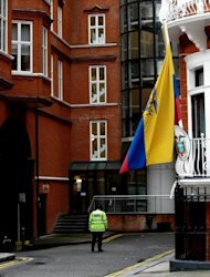 <p>A police officer is seen patrolling outside the Ecuadorian embassy in London where the WikiLeaks founder Julian Assange is seeking refuge, on June 24. Assange refused to comply with a British police order to turn himself in for extradition to Sweden and instead walked into the Ecuadoran embassy on June 19, asking for asylum.</p>